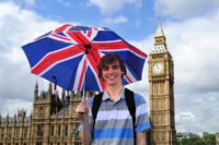 man with british flag umbrella and big ben